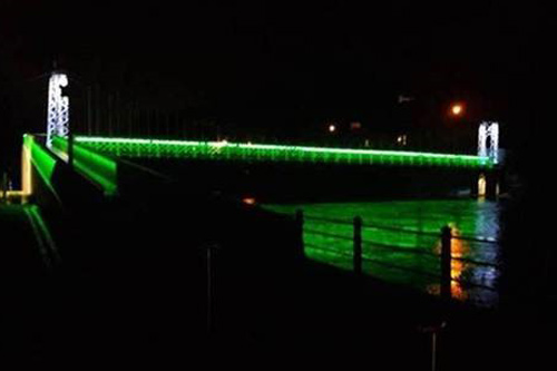 Shakey Bridge Cork by night lit in Green